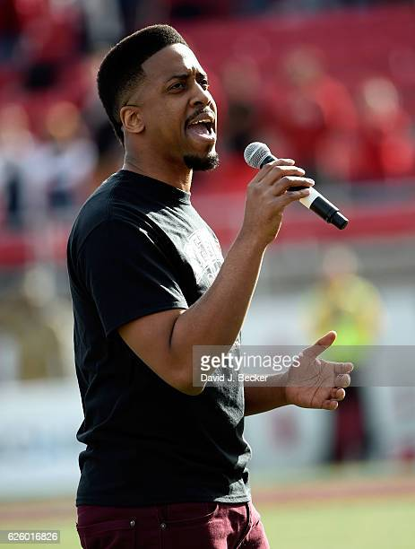 Singer Sham Lewis sings the American national anthem before the Nevada Wolf Pack and UNLV Rebels play at Sam Boyd Stadium on November 26 2016 in Las...