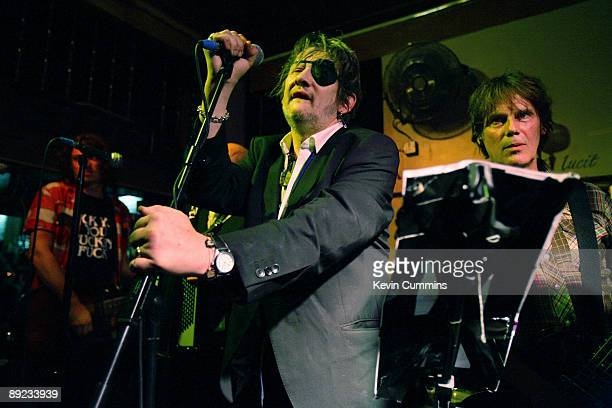 Singer Shane MacGowan and bassist Darryl Hunt performing with folkpunk group The Pogues at The Boogaloo pub Archway London 23rd July 2009