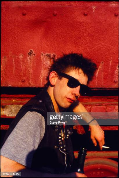 Singer Shane MacGowan of The Pogues, at a railway siding in Mississippi, USA, June 1988.