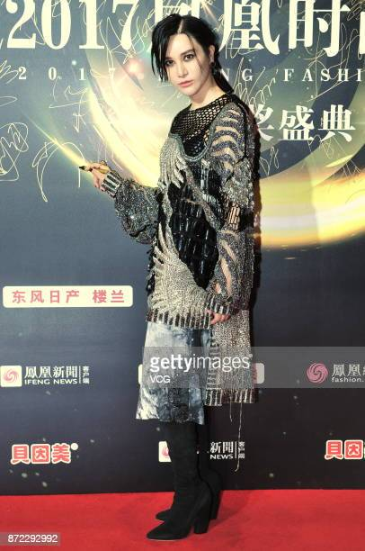 Singer Shang Wenjie arrives at the red carpet at the 2017 IFeng Fashion Choice ceremony on November 9, 2017 in Beijing, China.
