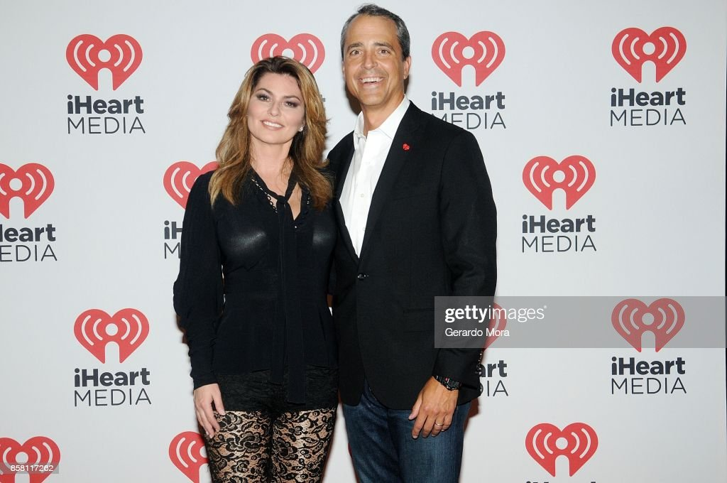 Singer Shania Twain (L) and Tim Castelli, President of National Sales, Marketing and Partnerships for iHeartMedia pose at a dinner party hosted by iHeartMedia during the ANA Masters of Marketing annual conference on October 5, 2017 in Orlando, Florida.