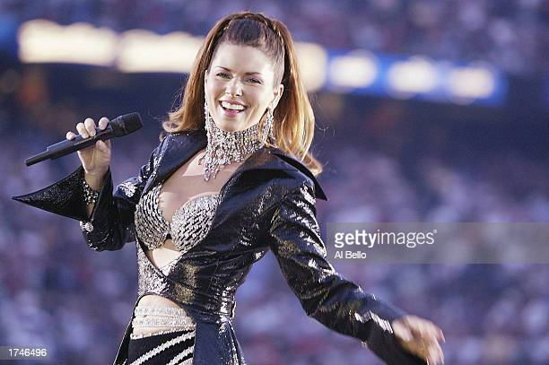 Singer Shania Twain performs during halftime of Super Bowl XXXVII between the Tampa Bay Buccaneers and the Oakland Raiders on January 26 2003 at...