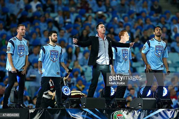Singer Shannon Noll performs before game one of the State of Origin series between the New South Wales Blues and the Queensland Maroons at ANZ...