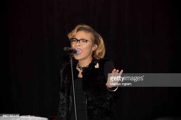Singer Sharon Moore performs onstage during the '5th Annual Caroling with Q Parker and Friends' at Atlanta Marriott Buckhead on December 11 2017 in...