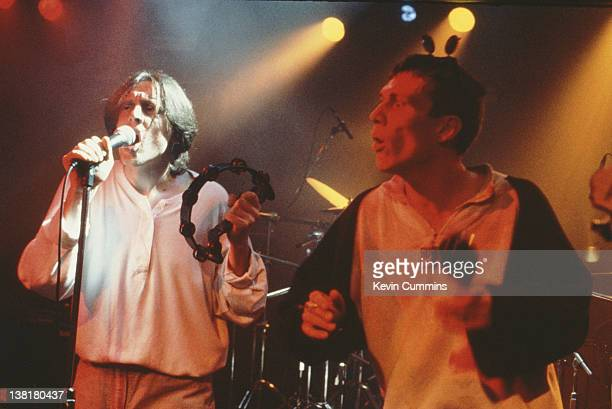 Singer Shaun Ryder and dancer Bez performing with the Happy Mondays circa 1990