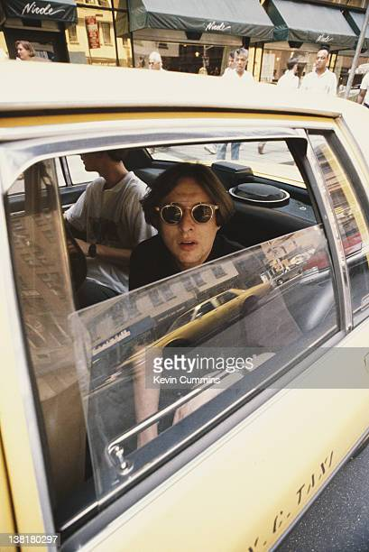 Singer Shaun Ryder of English pop group the Happy Mondays in a taxi New York July 1990
