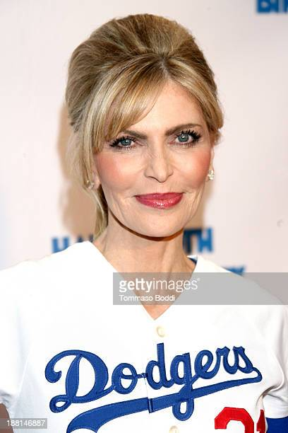 Singer Shawn King attends Larry King's surprise 80th birthday party held at Dodger Stadium on November 15 2013 in Los Angeles California