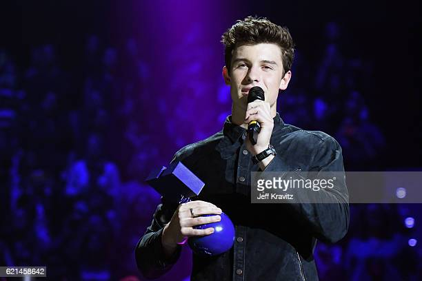 Singer Shawn Mendes accepts the award for Best Male on stage at the MTV Europe Music Awards 2016 on November 6 2016 in Rotterdam Netherlands