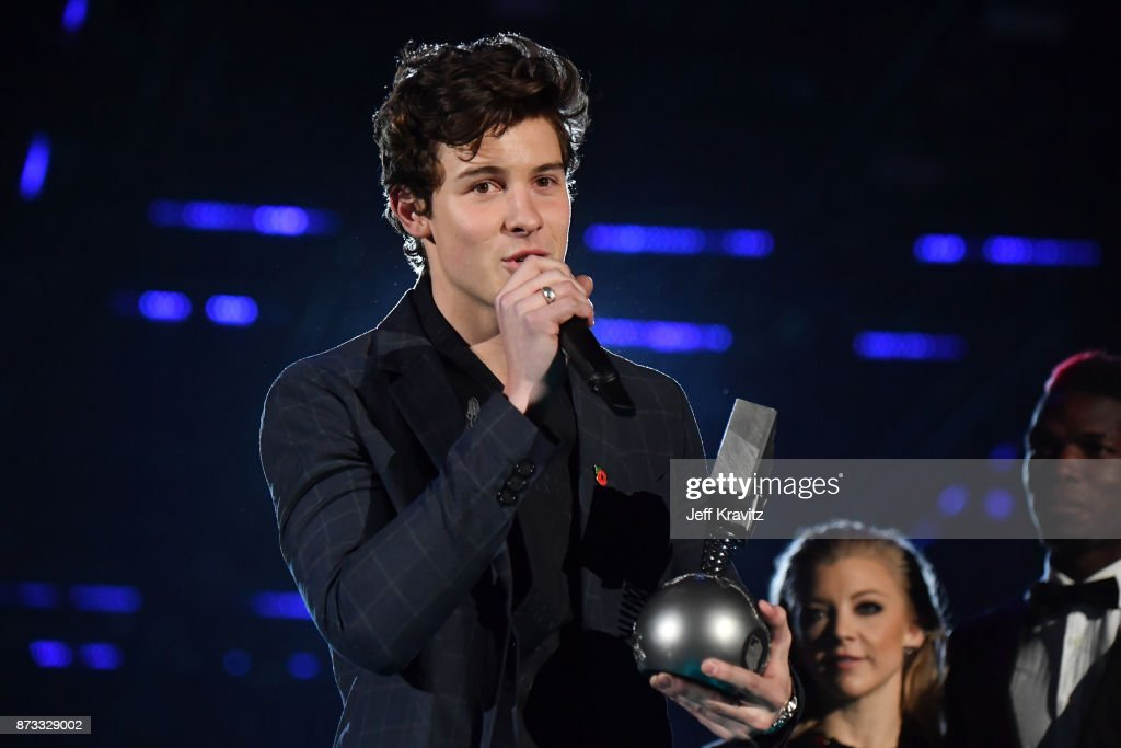 Singer Shawn Mendes accepts the award for best song on stage during the MTV EMAs 2017 held at The SSE Arena, Wembley on November 12, 2017 in London, England.