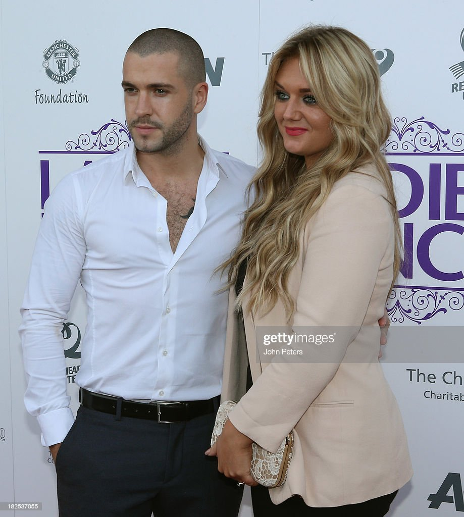 Singer Shayne Ward arrives with his partner at the Manchester United Foundation Ladies Lunch, raising money for The Christie Charity and Francis House Children's Hospice, at Old Trafford on September 30, 2013 in Manchester, England.