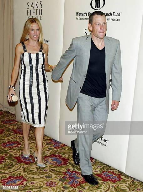 Singer Sheryl Crow and athlete Lance Armstrong arrive at Saks Fifth Avenue's Unforgettable Evening at the Regent Beverly Wilshire on March 1 2005 in...