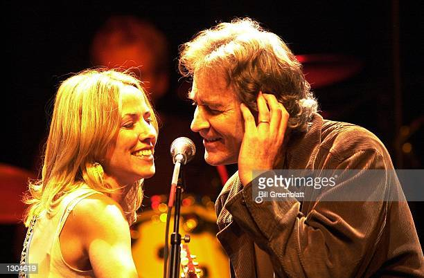 Singer Sheryl Crow and fellow Missourian Kevin Kline entertain thousands at a tribute concert in midtown St Louis November 3 2000 for the late...