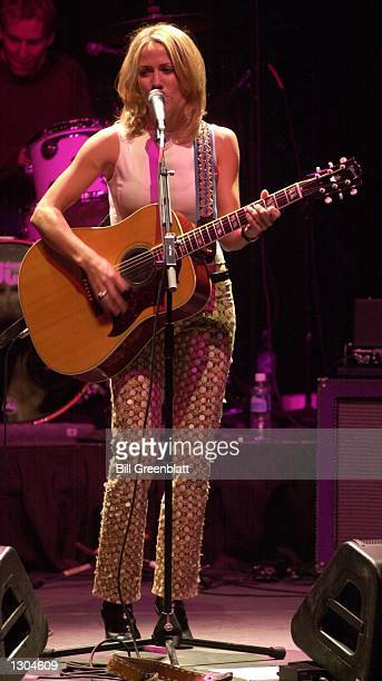 Singer Sheryl Crow entertains thousands at a tribute concert in midtown St Louis November 3 2000 for the late Missouri Governor Mel Carnahan Joining...