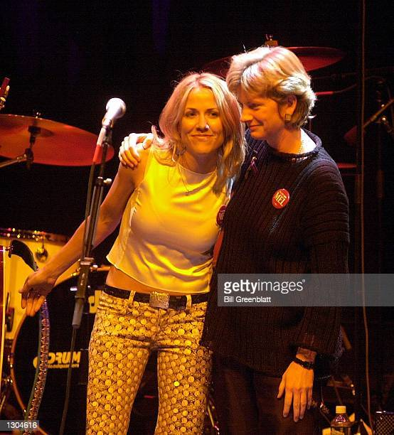 Singer Sheryl Crow gets a hug from Robin Carnahan daughter of the late Missouri Governor Mel Carnahan November 3 2000 at the end of a tribute concert...