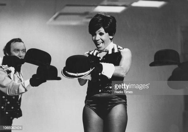 Singer Shirley Bassey pictured performing in costume June 19th 1976
