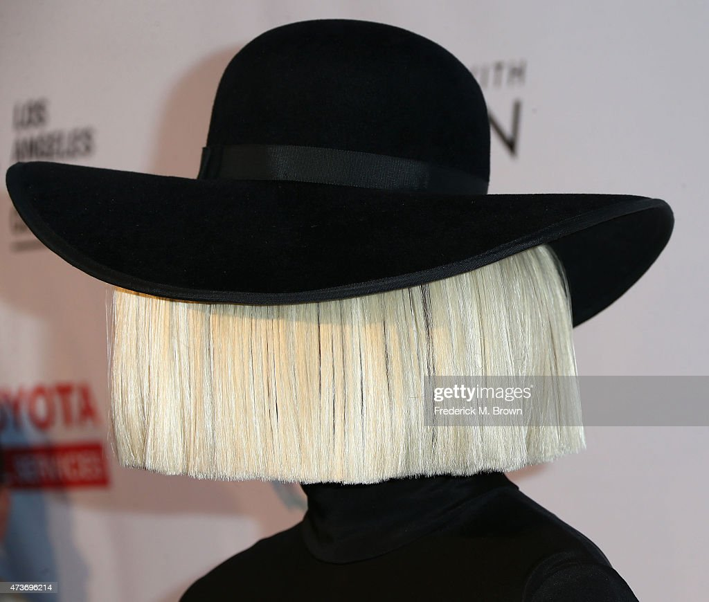 In Focus: Sia Hiding In Fashion From Wigs To Bows