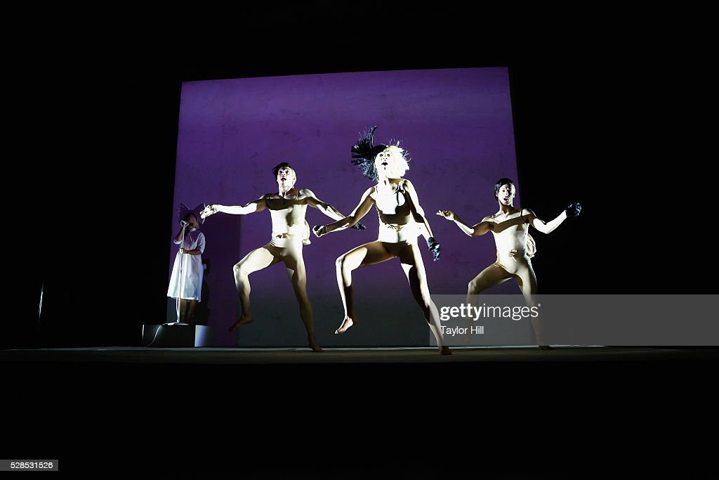Singer Sia performs with dancers during YouTube Brandcast