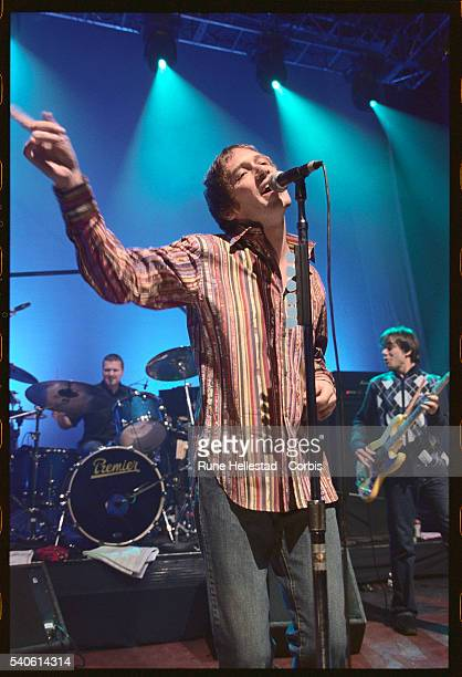 Singer Simon Fowler and bass guitarist Damon Minchella of Ocean Colour Scene perform with a drummer on stage at Shepherd's Bush Empire in London in...
