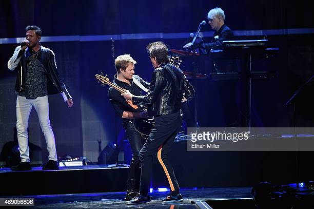 Singer Simon Le Bon touring guitarist Dom Brown bassist John Taylor and keyboardist Nick Rhodes of Duran Duran perform onstage at the 2015...