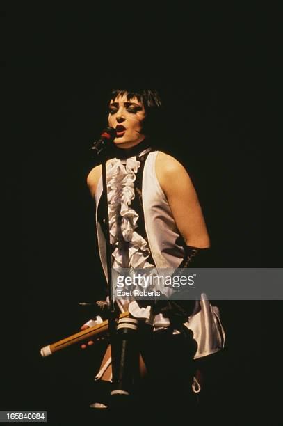Singer Siouxsie Sioux performing with English rock group Siouxsie and the Banshees USA 1988