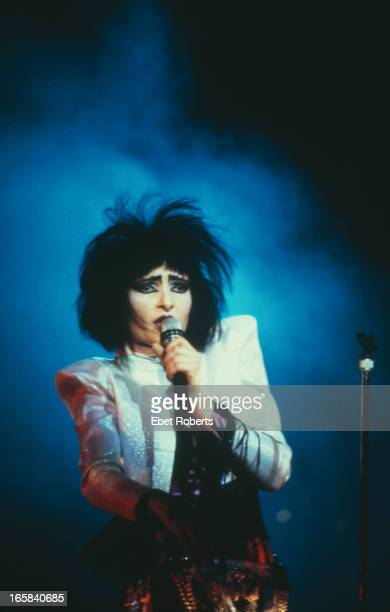 Singer Siouxsie Sioux performing with English rock group Siouxsie and the Banshees USA 1986
