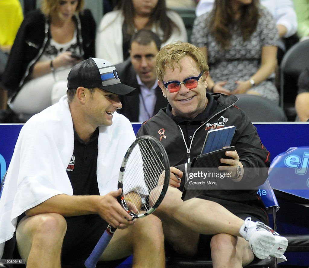 Singer Sir Elton John (L) and tennis player Andy Roddick smiles during the Mylan World TeamTennis Matches at ESPN Wide World of Sports Complex on November 17, 2013 in Lake Buena Vista, Florida.