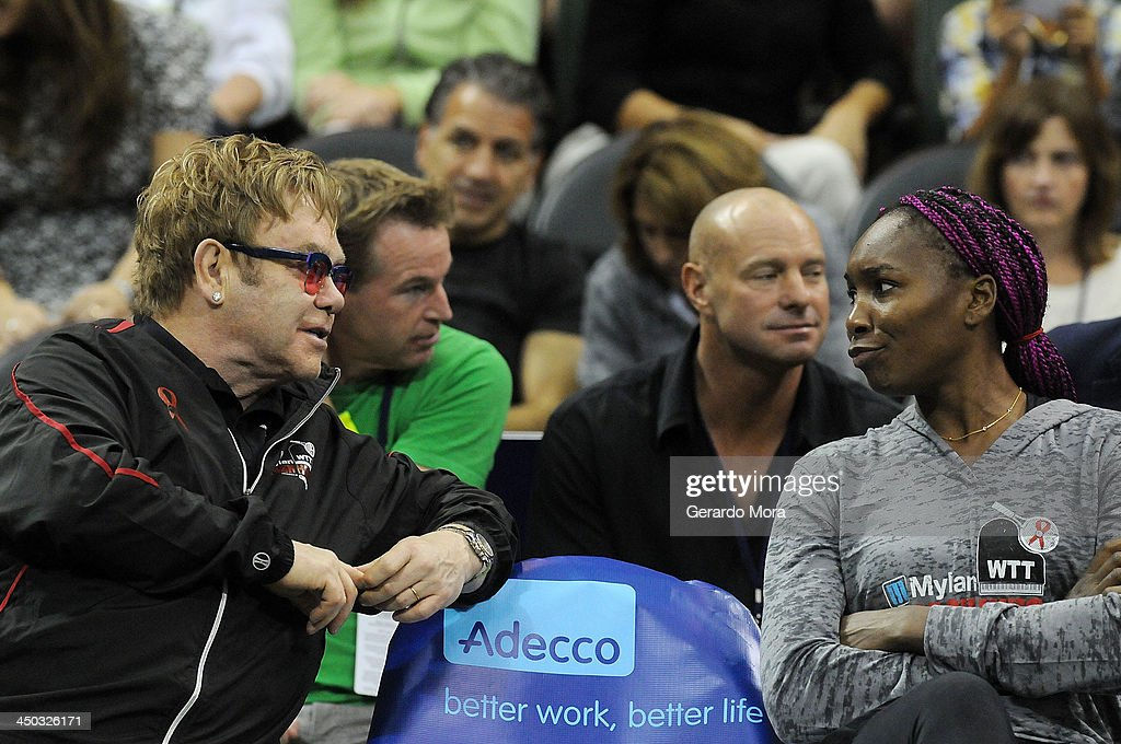 Singer Sir Elton John (L) and tennis player Venus Williams attend the Mylan World TeamTennis Matches at ESPN Wide World of Sports Complex on November 17, 2013 in Lake Buena Vista, Florida.