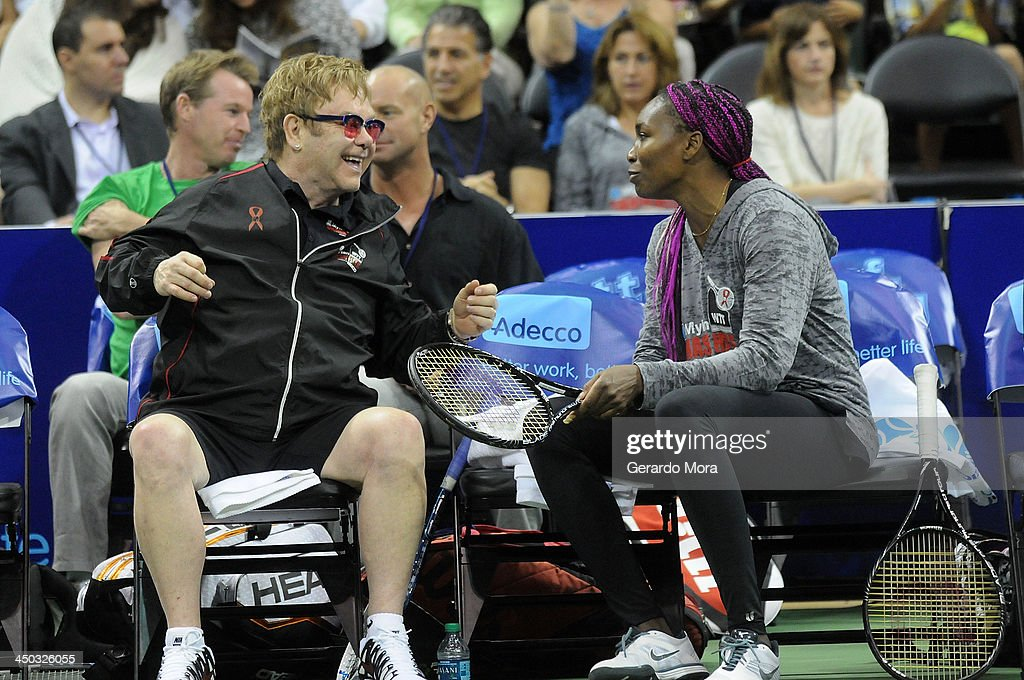 Singer Sir Elton John (L) and tennis player Venus Williams smile during the Mylan World TeamTennis Matches at ESPN Wide World of Sports Complex on November 17, 2013 in Lake Buena Vista, Florida.