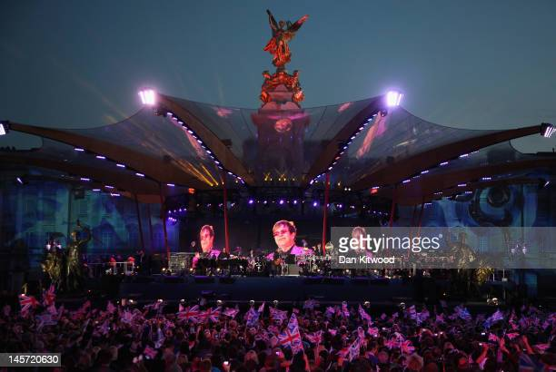 Singer Sir Elton John performs on stage during the Diamond Jubilee concert at Buckingham Palace on June 4 2012 in London England For only the second...