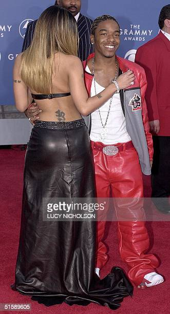 US singer Sisqo arrives at the 43rd Annual Grammy Awards with his girlfriend Tera in Los Angeles 21 February 2001 Sisqo is nominated for Best RB...