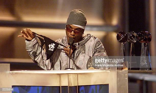Singer Sisqo sports a thong while collecting six awards at the 2000 Billboard Music Awards at the MGM Grand Hotel and Casino Las Vegas NV Tuesday...