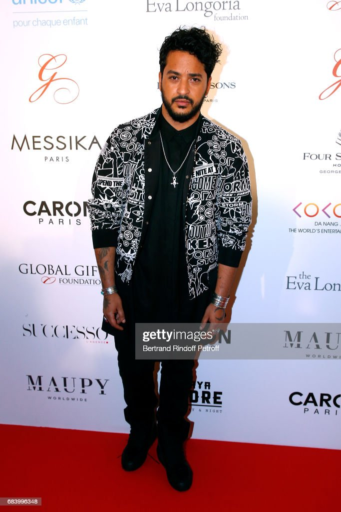 Singer Slimane attends the 'Global Gift, the Eva Foundation' Gala : Photocall at Hotel George V on May 16, 2017 in Paris, France.