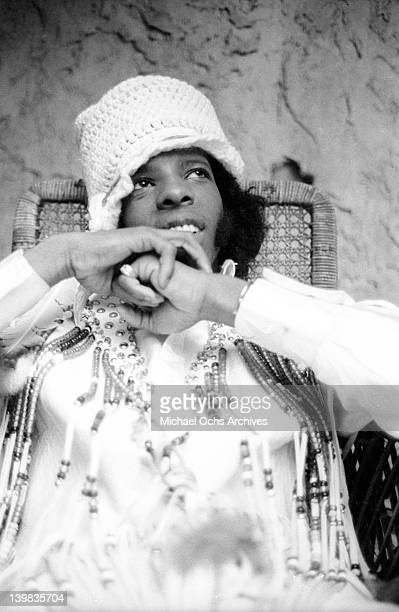 Singer Sly Stone of the psychedelic soul group 'Sly and the Family Stone' poses for a portrait on the Warner Brothers lot in circa 1970 in Los...