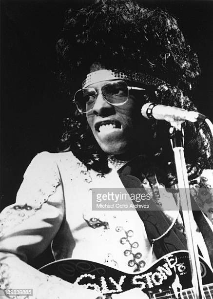 Singer Sly Stone of the psychedelic soul group 'Sly And The Family Stone' performs onstage wearing sunglasses with an acoustic guitar in circa 1972