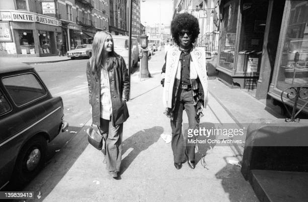 Singer Sly Stone of the psychedelic soul group 'Sly And The Family Stone' walks down the street with a woman on March 9 1969
