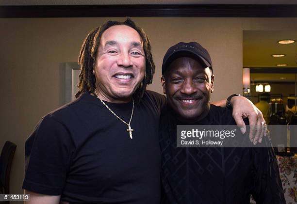 Singer Smokey Robinson poses for a photograph with his friend Donnie Simpson on October 8 2004 in Washington DC Simpson is the host of Black...