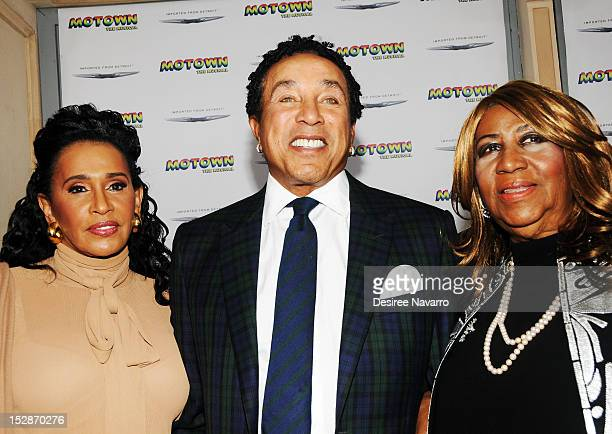 Singer Smokey Robinson with his wife Frances and singer Aretha Franklin attend the Motown The Musical Broadway opening night at Nederlander Theatre...