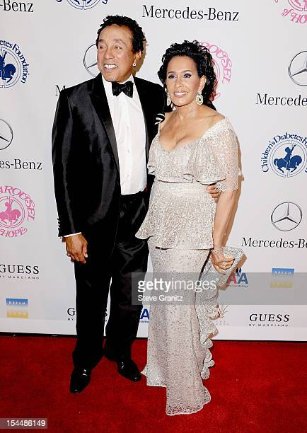 Singer Smokey Robinson with his wife Frances arrive at the 26th Anniversary Carousel Of Hope Ball presented by MercedesBenz at The Beverly Hilton...