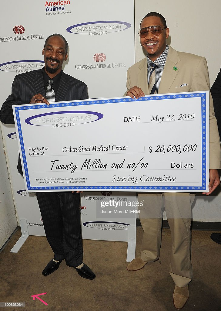 Singer Snoop Dogg and basketball player Carmelo Anthony pose backstage at the 25th Anniversary Of Cedars-Sinai Sports Spectacular held at the Hyatt Regency Century Plaza Hotel on May 23, 2010 in Los Angeles, California.