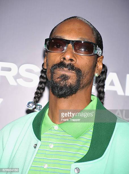 Singer Snoop Dogg arrives at Screen Gems' Takers World Premiere held at the Arclight Cinema Cinerama Dome in Hollywood