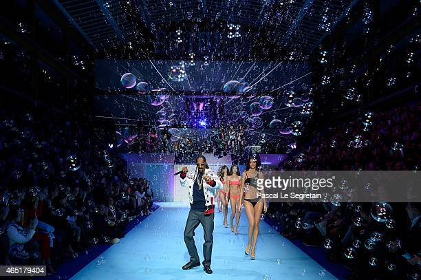 Singer Snoop Dogg performs during the ETAM show finale as part of the Paris Fashion Week Womenswear Fall/Winter 2015/2016 at Piscine Molitor on March...