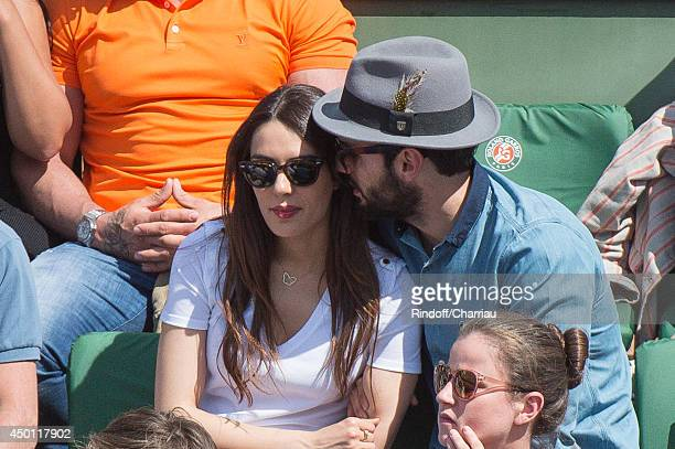 Singer Sofia Essaidi and her companion attend the Roland Garros French Tennis Open 2014 Day 12 attends the Roland Garros French Tennis Open 2014 Day...