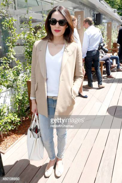 Singer Sofia Essaidi attends the Roland Garros French Tennis Open 2014 Day 12 on June 5 2014 in Paris France