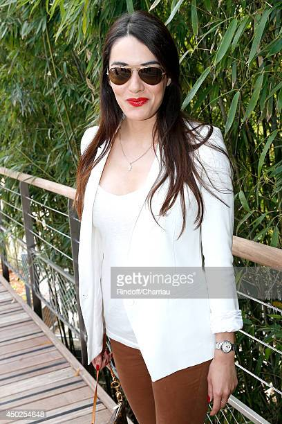 Singer Sofia Essaidi attends the Roland Garros French Tennis Open 2014 Day 14 on June 7 2014 in Paris France