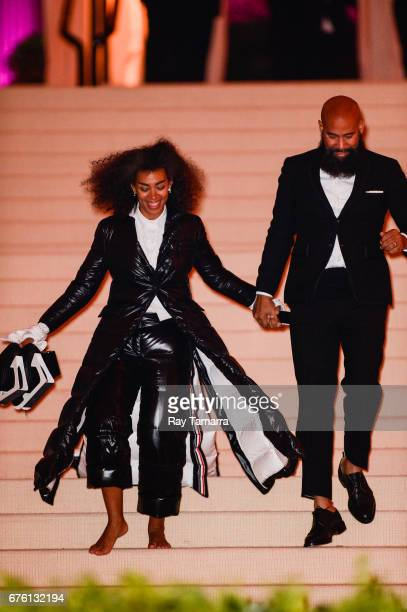 """Singer Solange Knowles and director Alan Ferguson leave the Rei Kawakubo/Comme des Garcons: Art Of The In-Between"""" Costume Institute Gala at the..."""