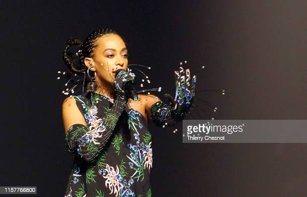 Singer Solange Knowles performs during the runway during the Kenzo Menswear Spring Summer 2020 show as part of Paris Fashion Week on June 23, 2019 in...