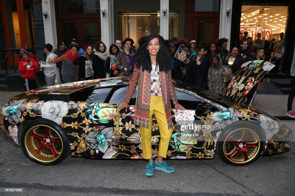 Singer Solange Knowles poses in front of a Lamborghini Murcielago decorated by Rashaad Newsome to celebrate the release of her 'Saint Heron' compilation album at Opening Ceremony in Soho on November 10, 2013 in New York City.