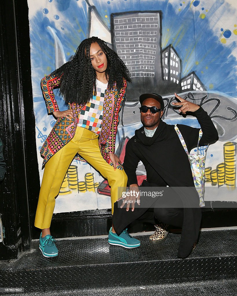 Singer Solange Knowles poses with fans to celebrate the release of her 'Saint Heron' compilation album outside Opening Ceremony in Soho on November 10, 2013 in New York City.