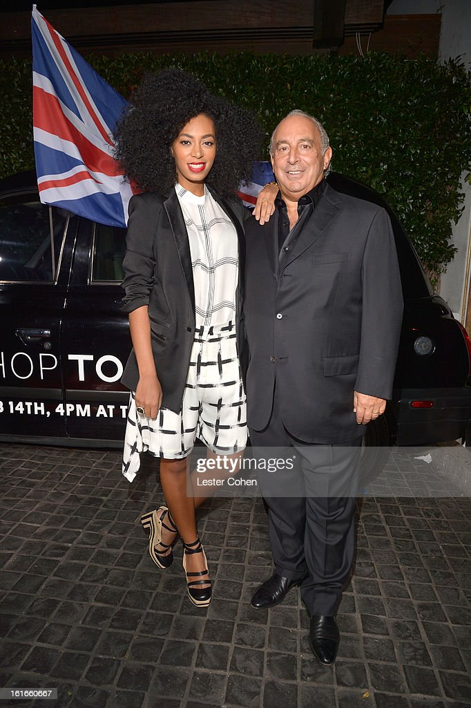 Singer Solange Knowles, wearing Topshop, and proprietor Sir Philip Green arrive at the Topshop Topman LA Opening Party at Cecconi's West Hollywood on February 13, 2013 in Los Angeles, California.