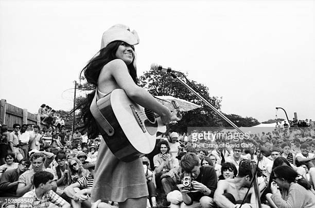Singer songwriter and activist Buffy SainteMarie performs at the Newport Folk Festival in July 1967 in Newport Rhode Island